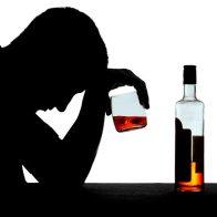 Алкоголизмом